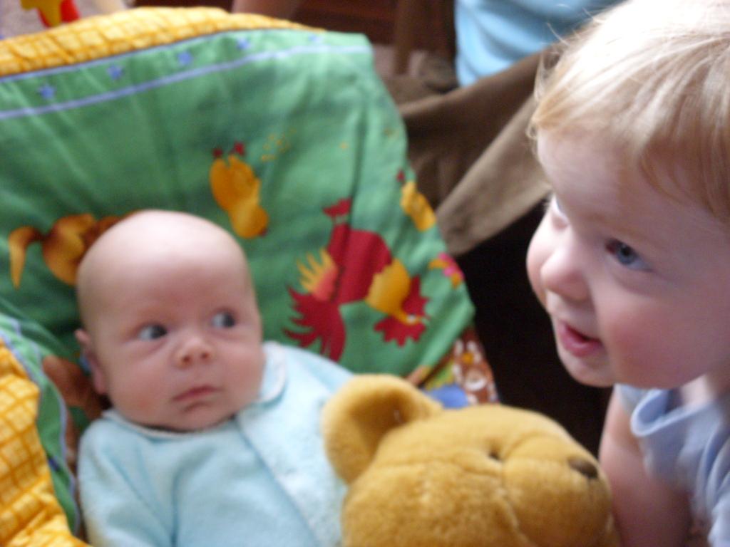 Sharing his teddy bear