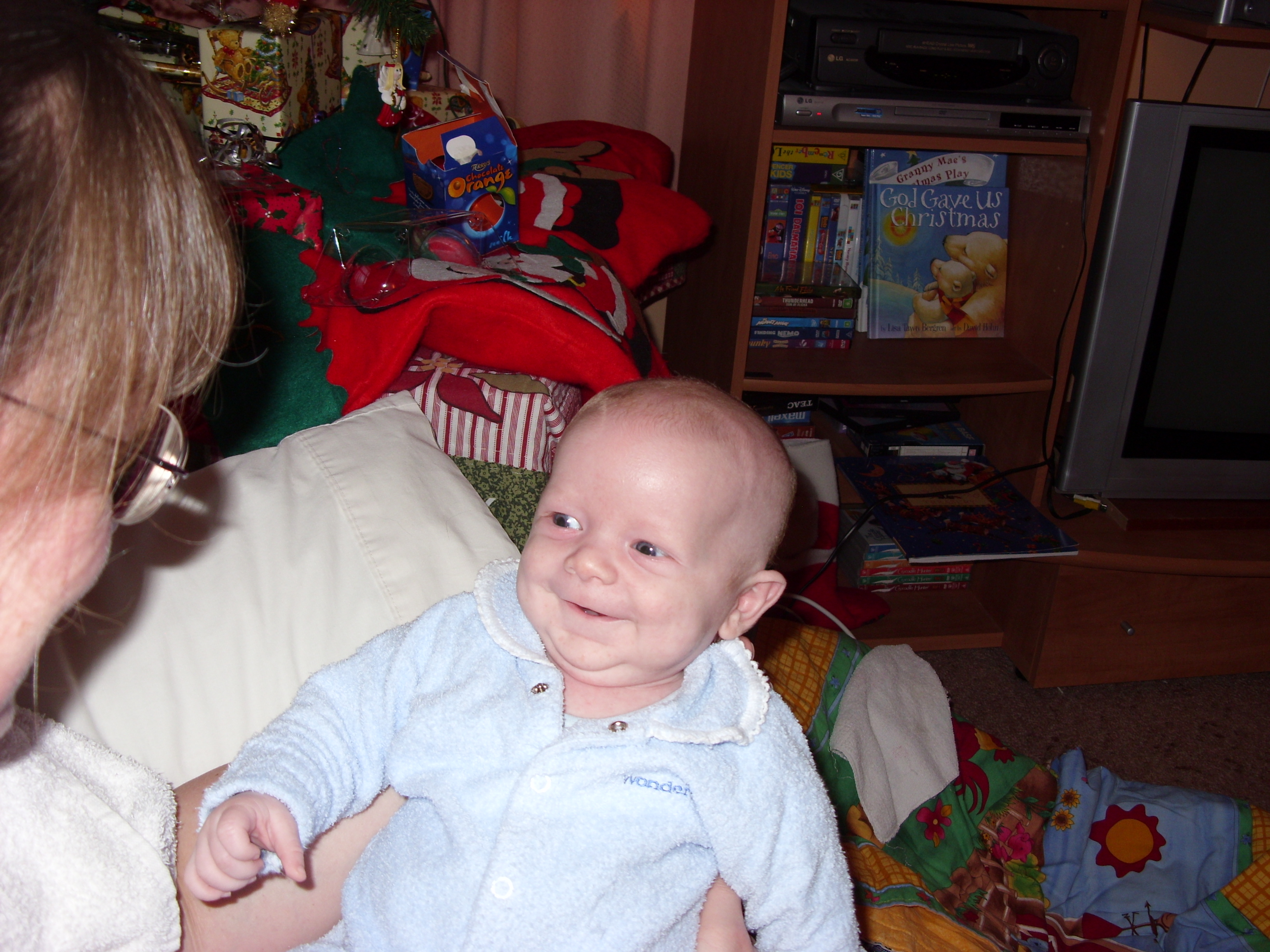 Alex smiling at his mum on his first Christmas