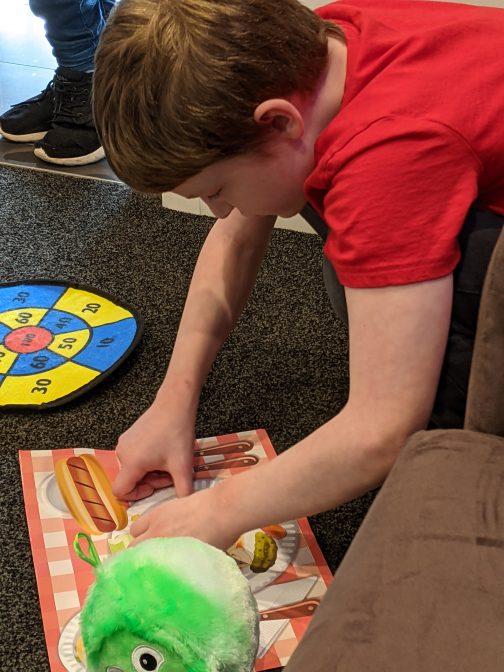 Alex with a sticker mat